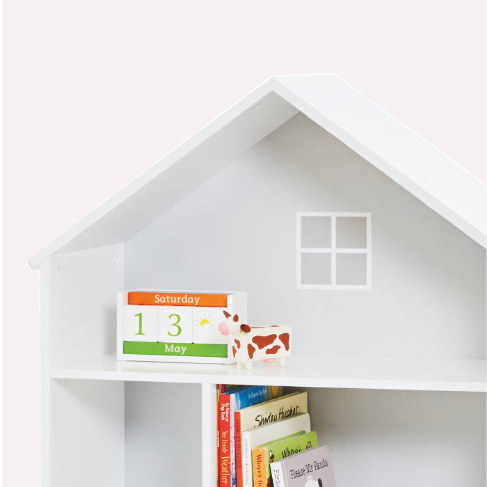White book shelf in the shape of a house