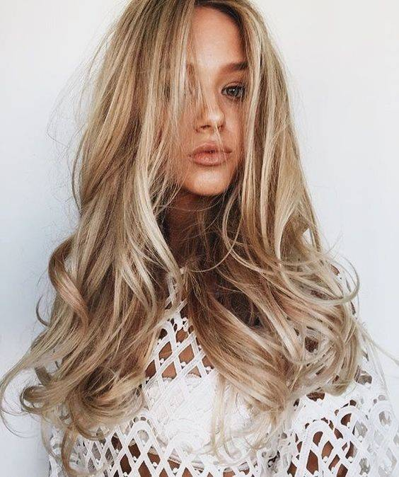 Beachy blonde haired woman with loose curls