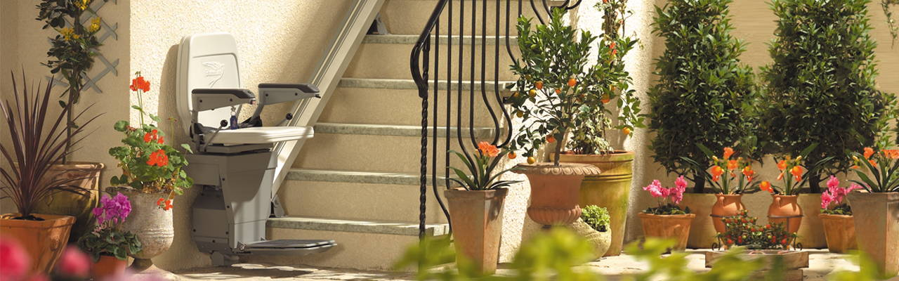 Stannah 320 outdoor stair lift chair straight banner | VIVA Mobility USA - Orlando, FL