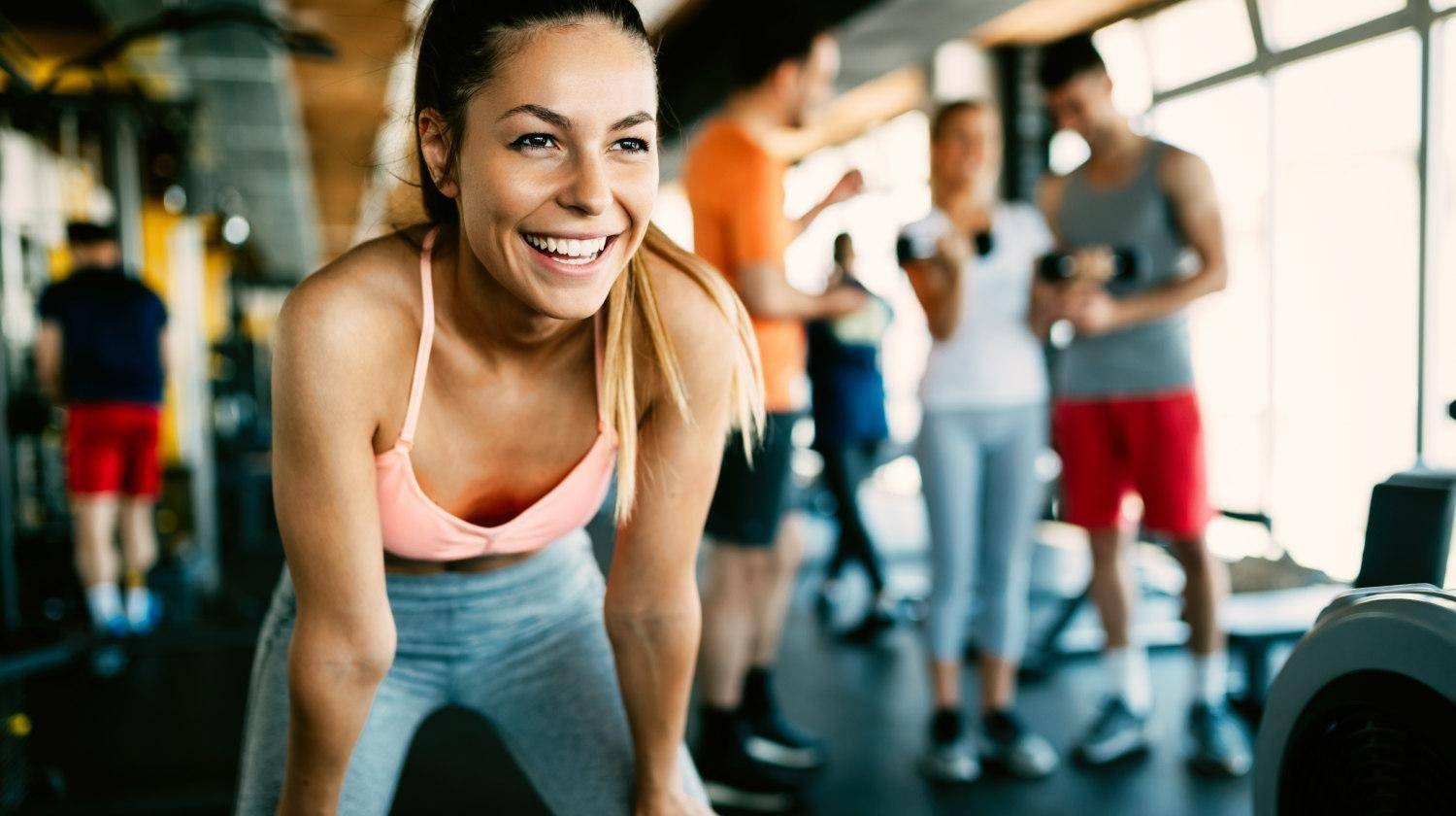 Featured | Close up image of attractive fit woman in gym | How Exercise Improves Cognitive Function and Overall Brain Health