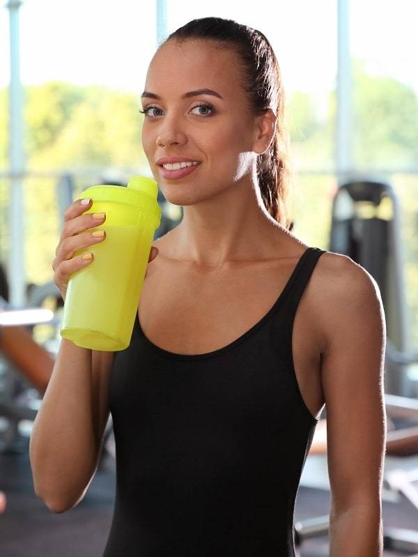 Girl Drinking Natural Protein Powder