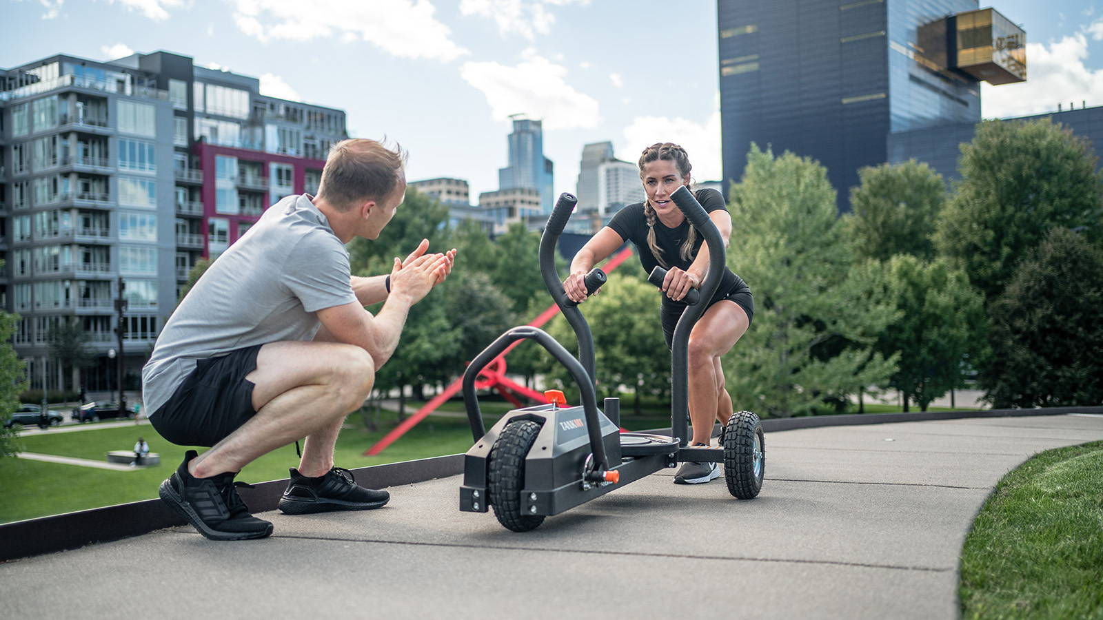 Two people working out using Tank M1 in city