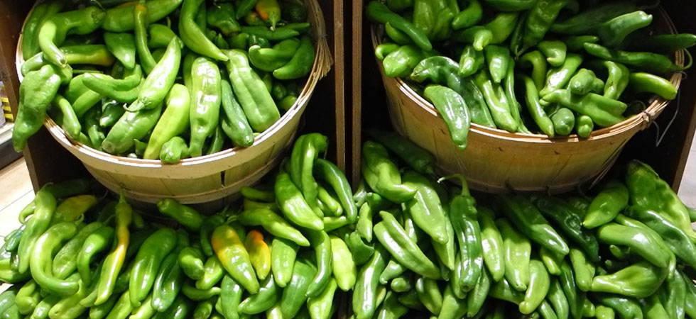 Image of fresh hatch peppers in a bin