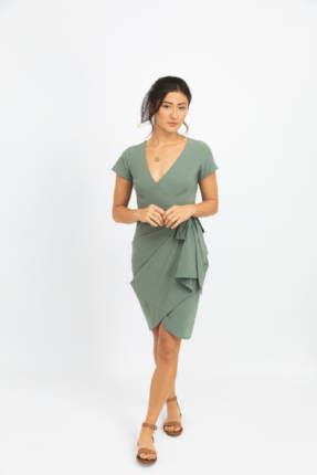 Kosan Mineral green dress snapped up to make it short.