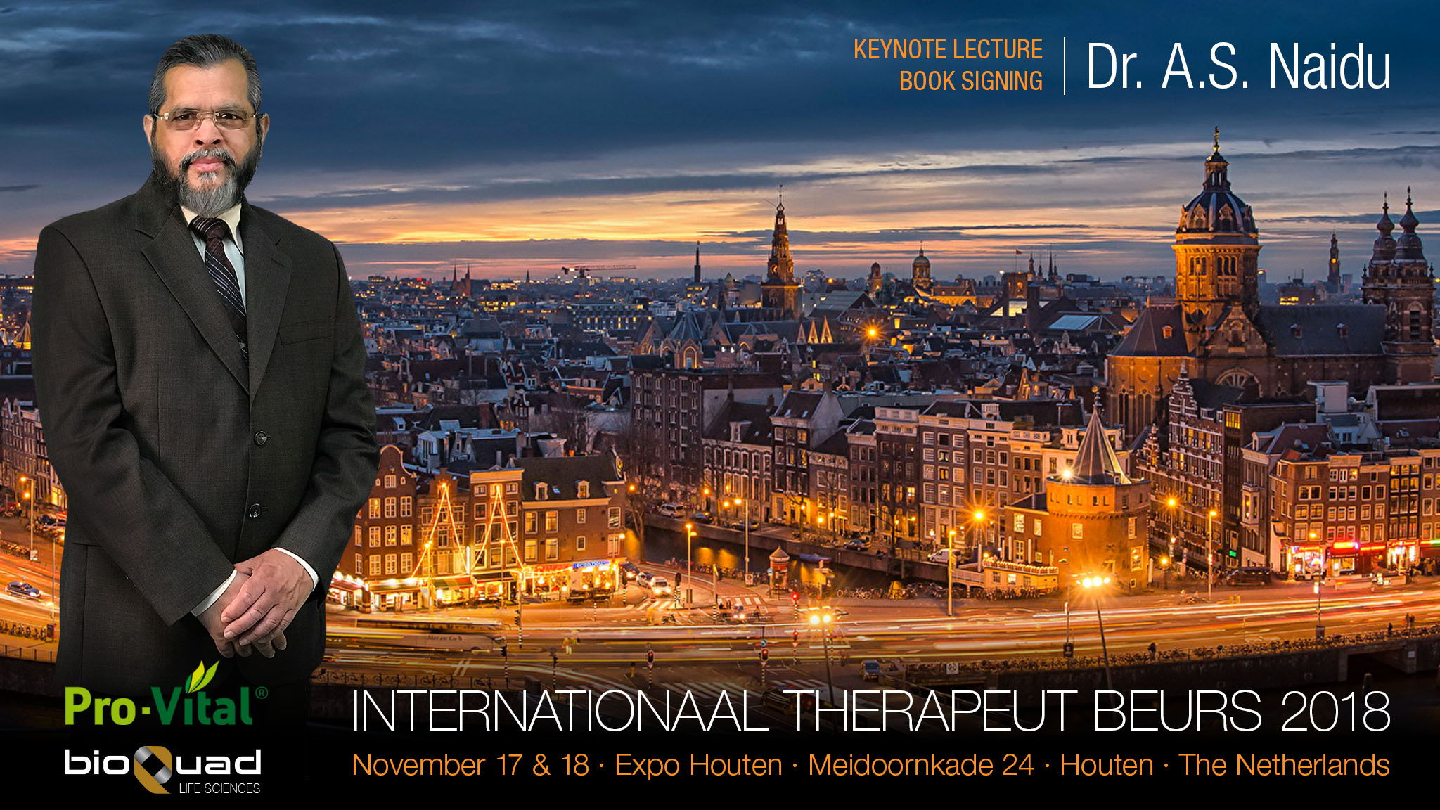 Dr. Naidu standing in front of Amsterdam skyline