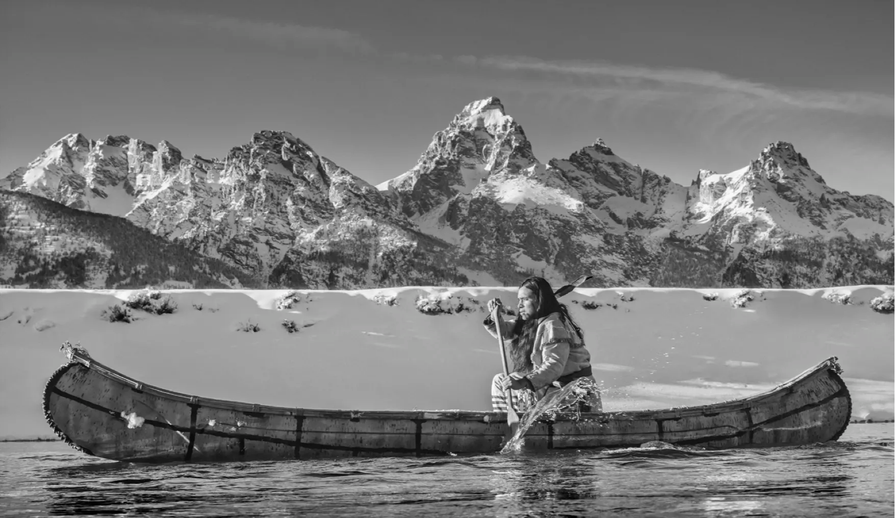 David Yarrow Photography. Sorrel Sky Gallery. Fine Art Photography. Western Photography. Super model photography. David Yarrow Prints. David Yarrow Pictures.  David Yarrow Photos. Native american canoeing in from of the grand tetons in wyoming