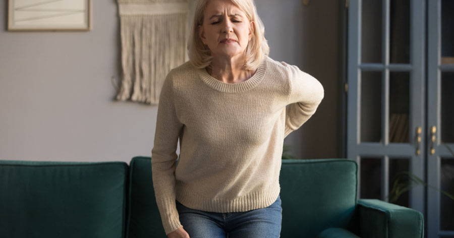senior woman arthritis back pain