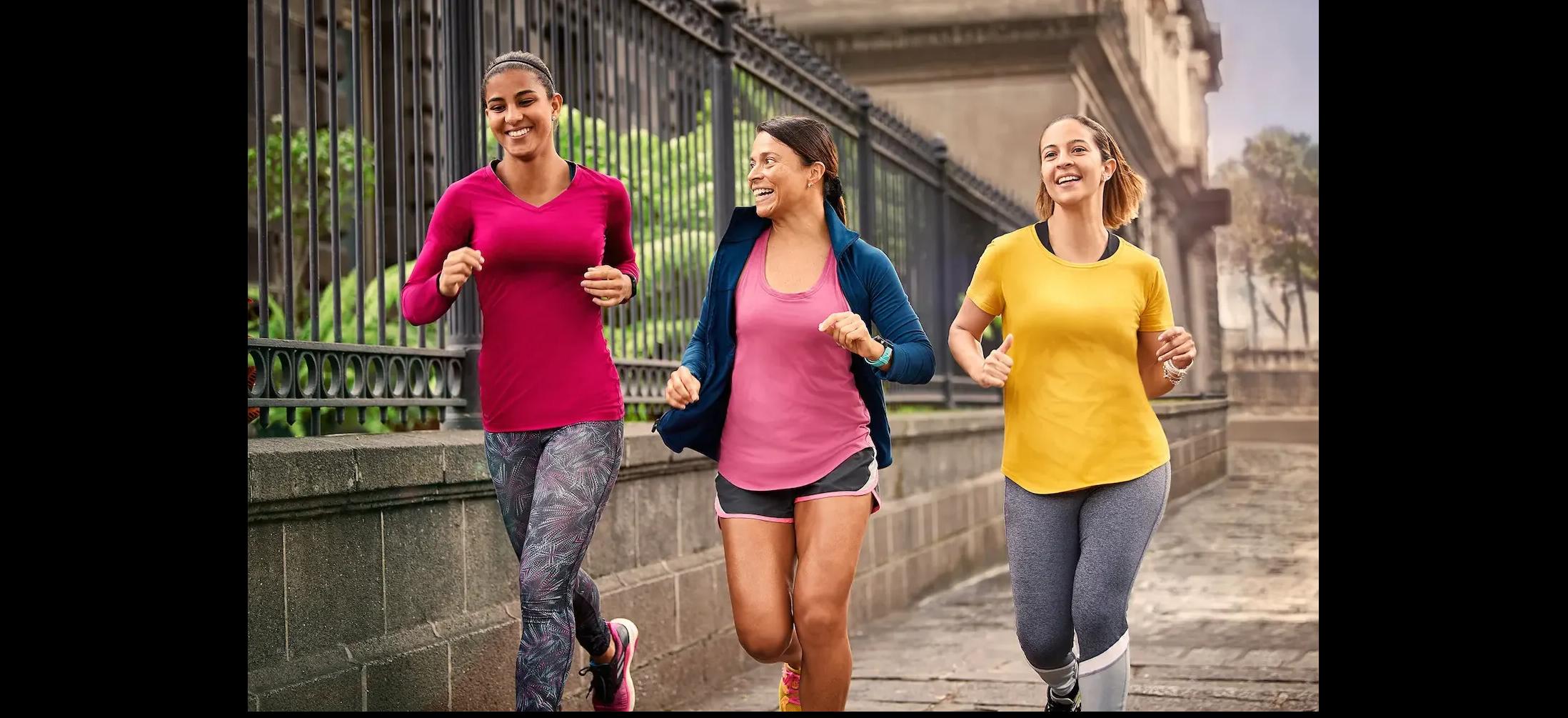 Three women with Garmin Forerunner running  watches running together