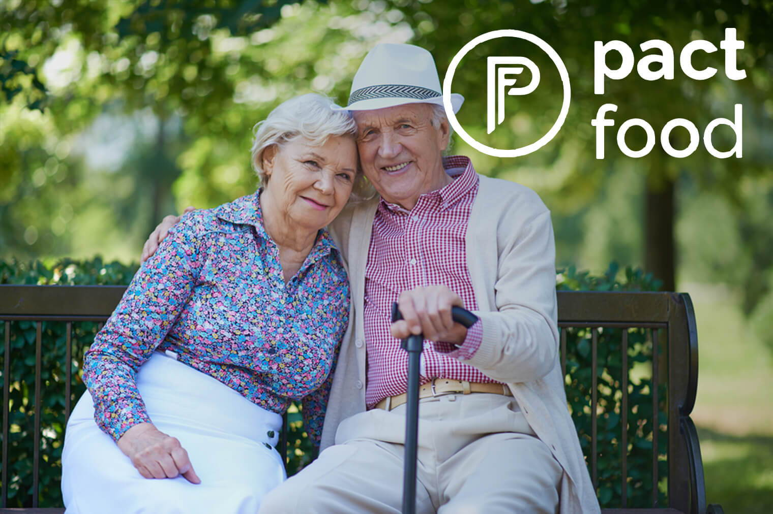 Elderly Couple Sitting In A Park