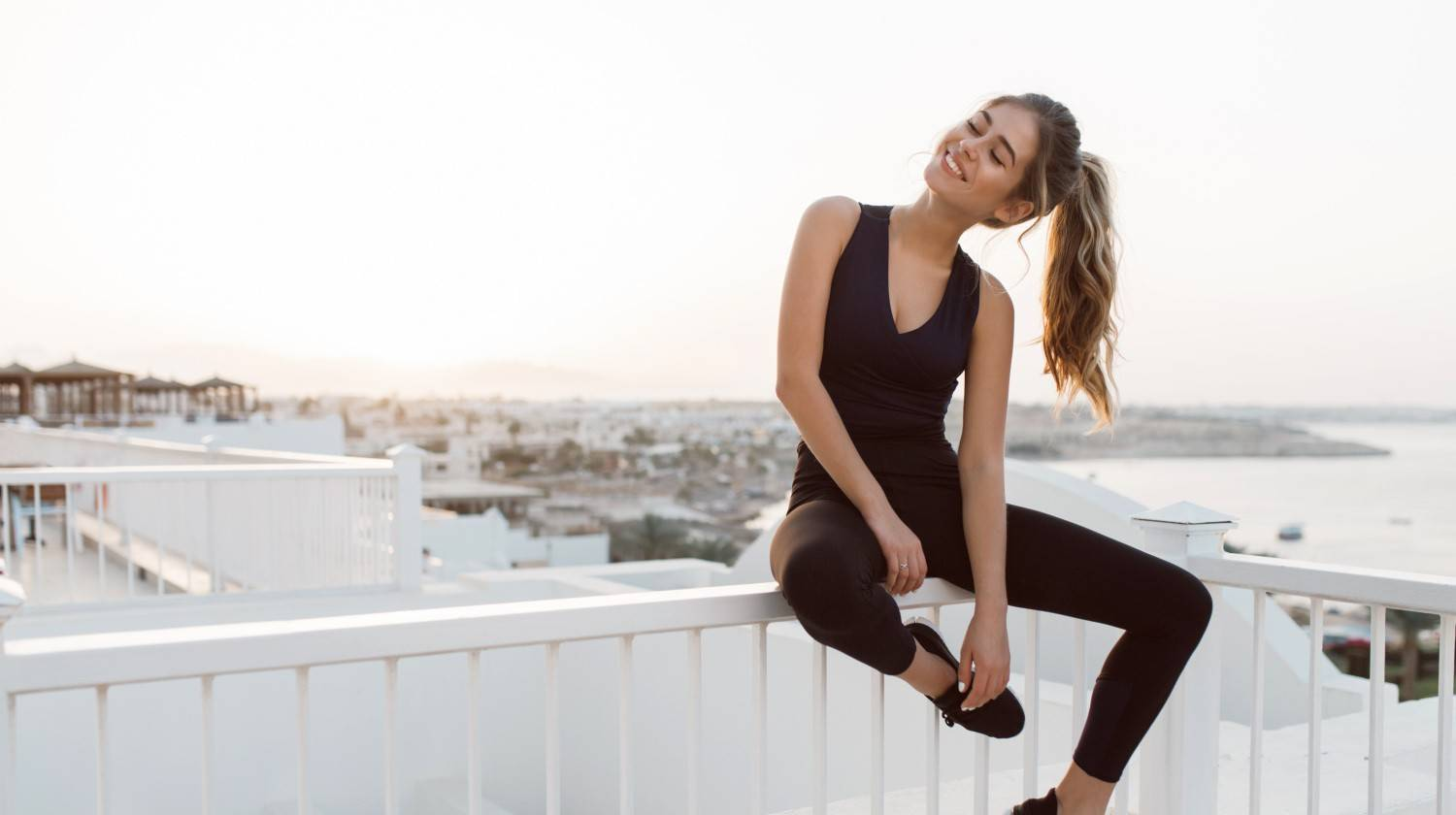 Featured | Excited attractive young woman in sportswear enjoying sunrise | The Best Vitamin For Stress Relief, Inflammation and Improved Mood