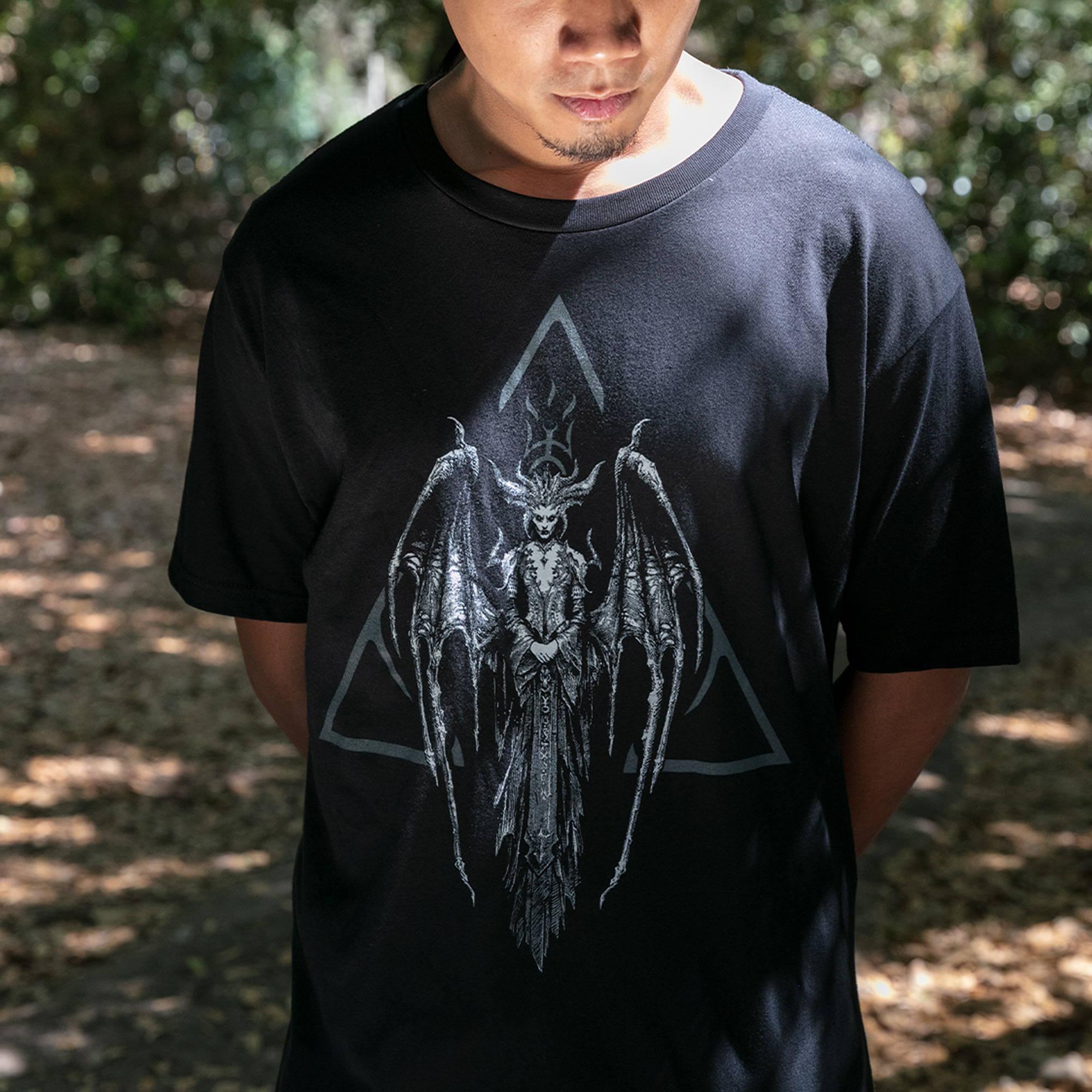 Male model wearing a Diablo hat and shirt