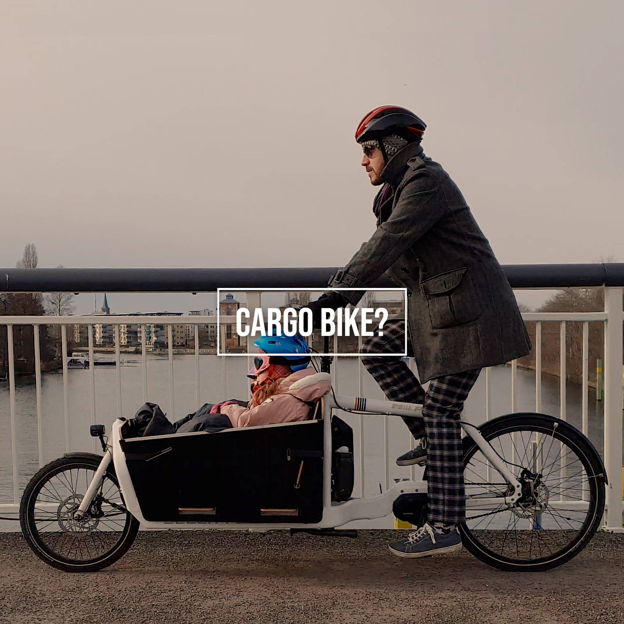 Cargo bike with wheels and saddler secured against theft