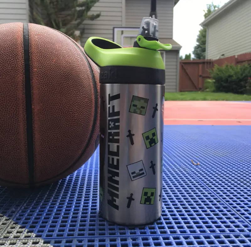 Image showing the Minecraft Mob Atlantic Bottle on the ground next to a basketball