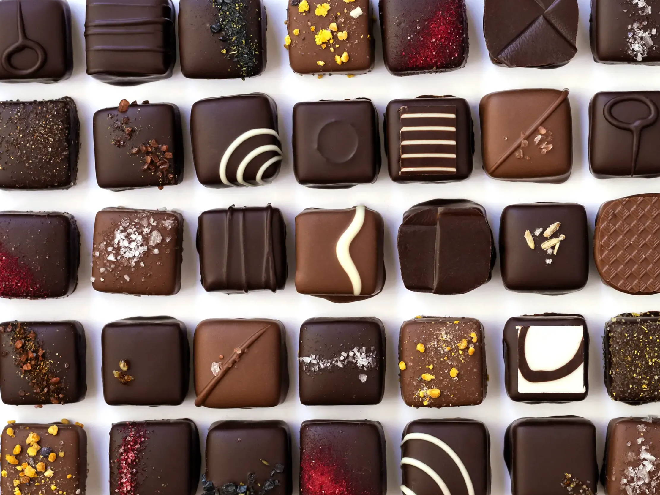 Assortment of delicious handmade confections with specialty decorations perfect for your special event.