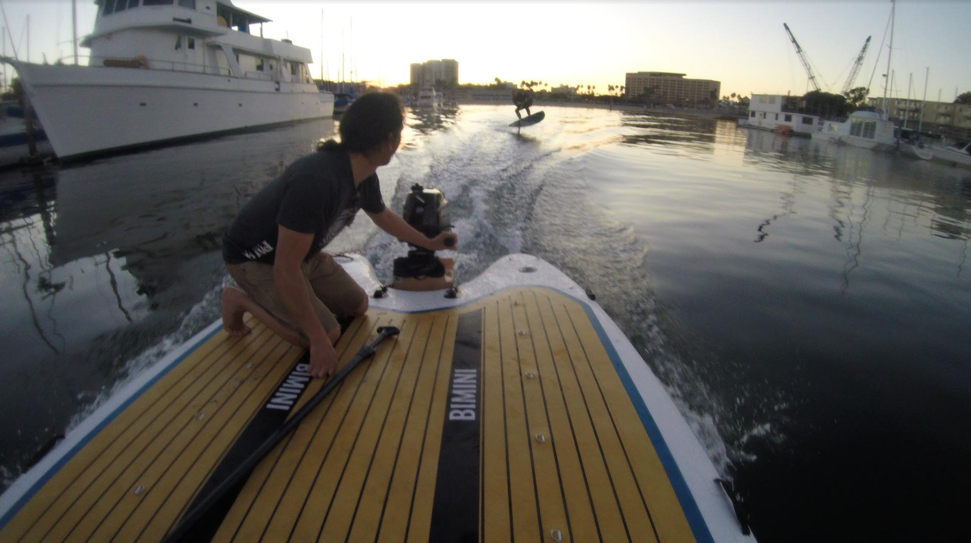 Bimini pau hana sup in Venice with hydrofoil dragging