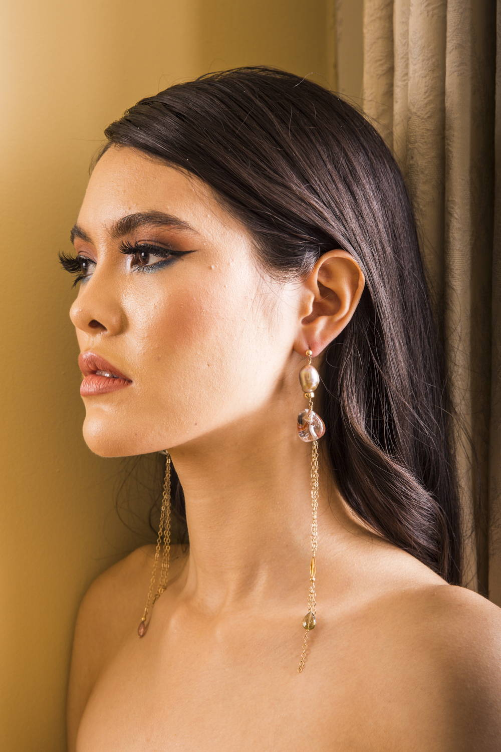 Siren Style Number One: One of our sirens models The Rock Crystal Chandelier Earrings - Mismatched organic rock crystal nuggets with rust/moss inclusions hang from pale pink baroque pearls, trailing citrine and watermelon tourmaline drops.