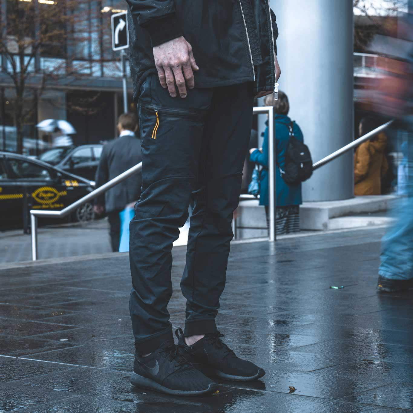 Man standing in city wearing the Brise Pant