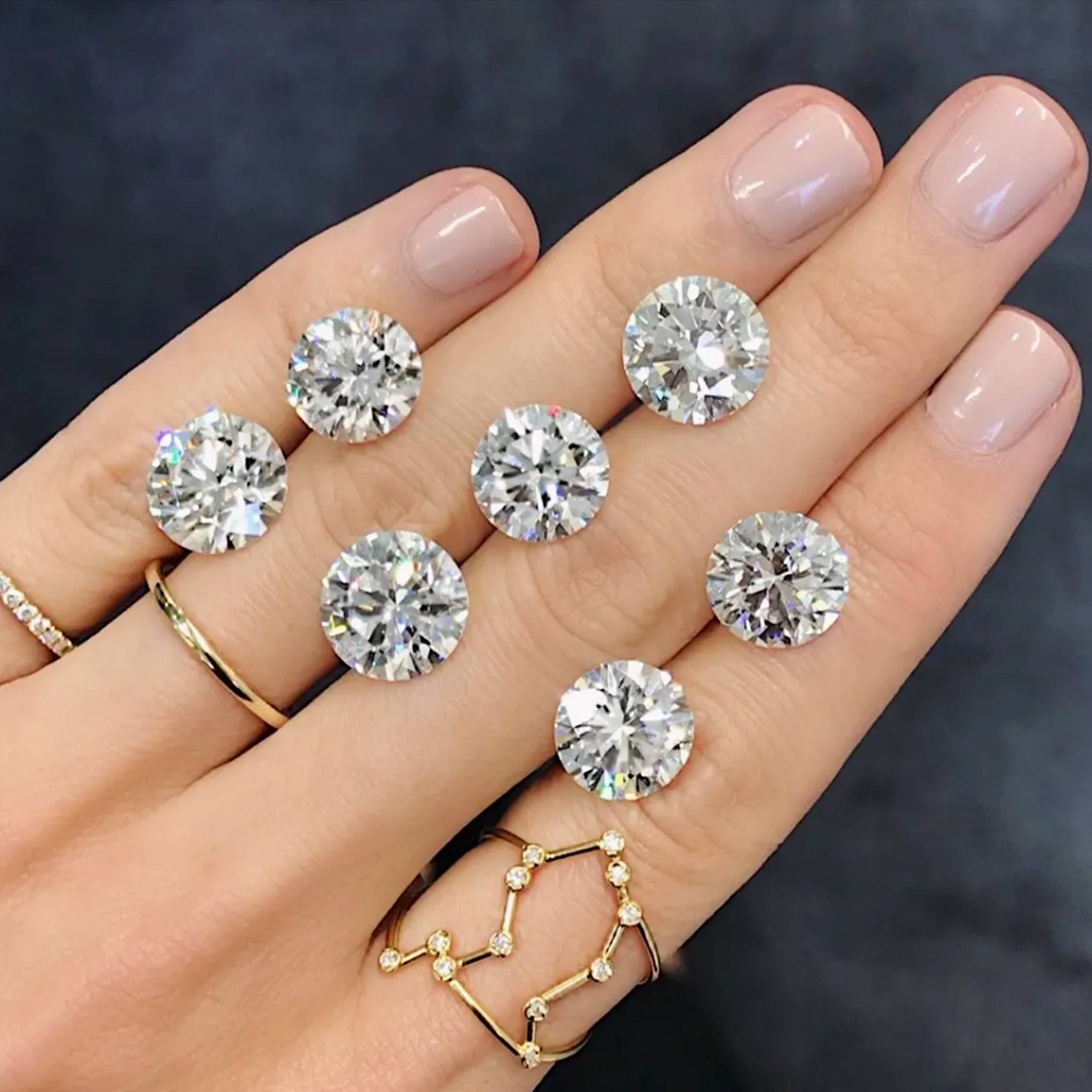 Loose diamonds on a hand
