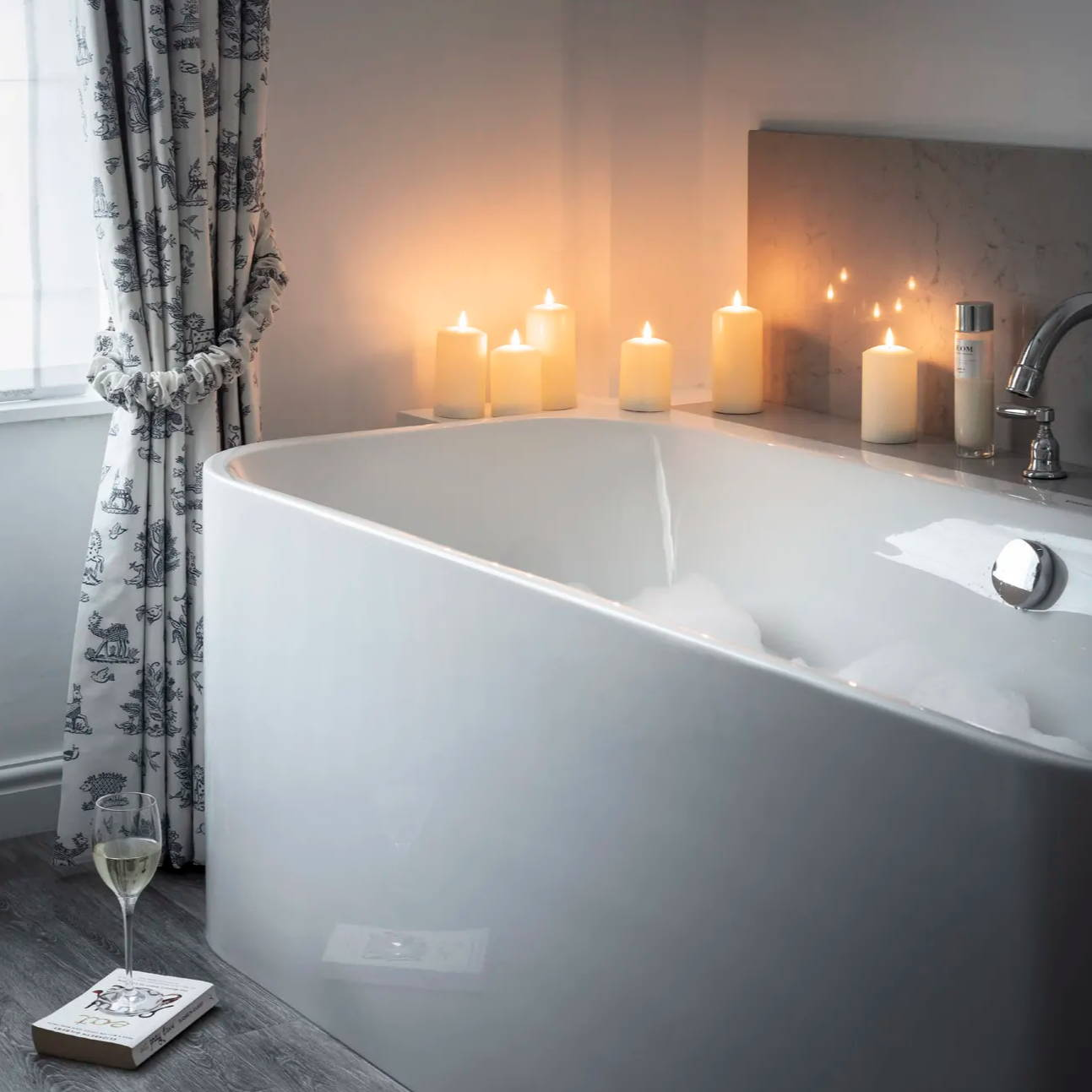 battery led pillar candles placed along the bath edge