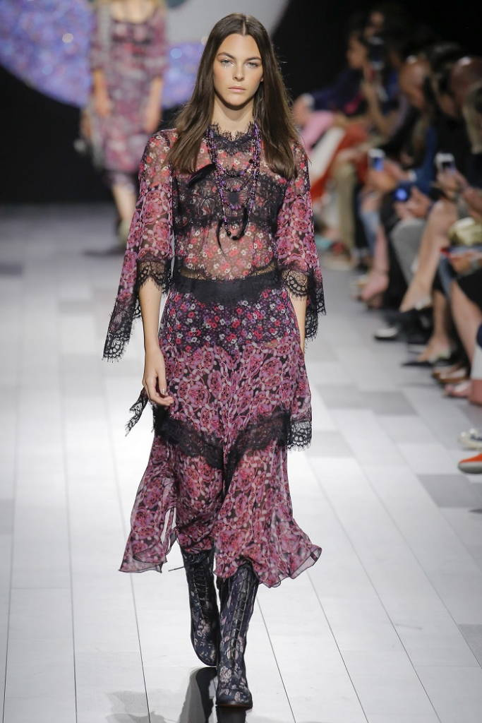Girl on runway in floral dress