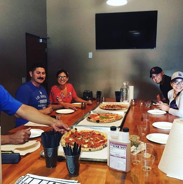 brew school students enjoying pizza
