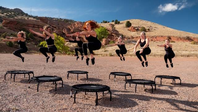 People Jumping On Trampolines