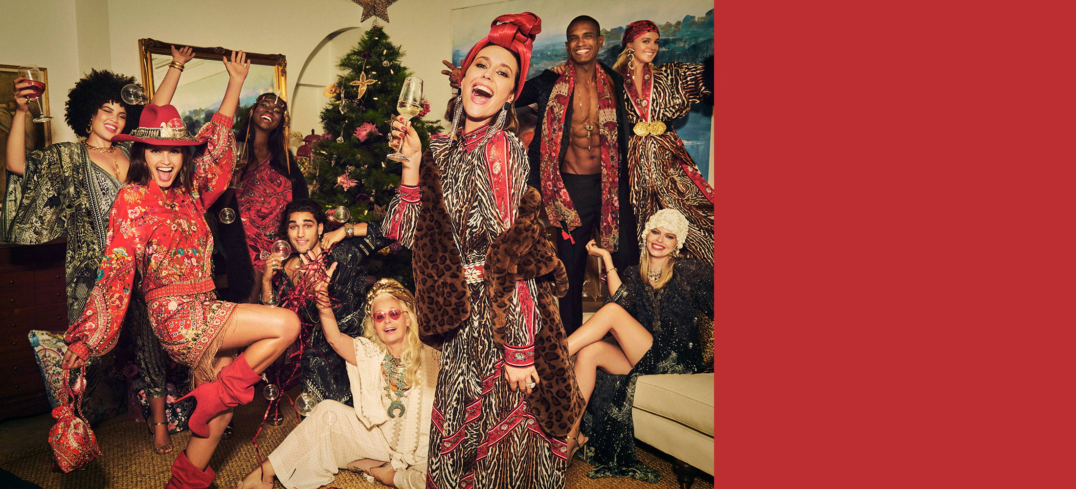 Models in CAMILLA outfits at a holiday party