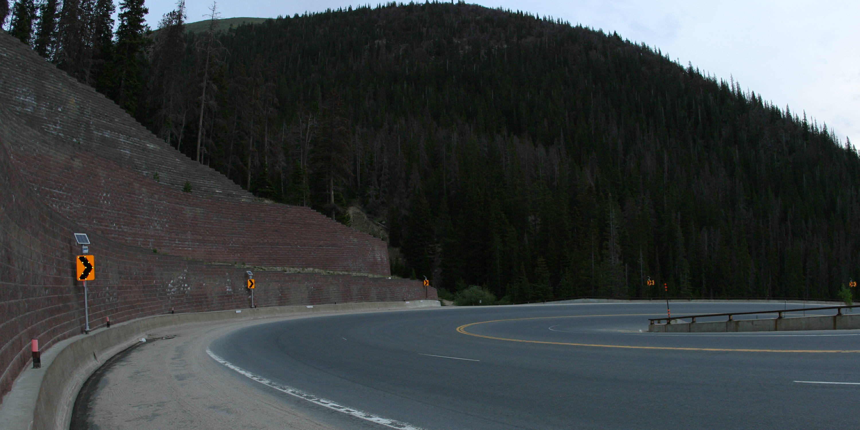 Mountain road with LED-enhanced curve warning signs