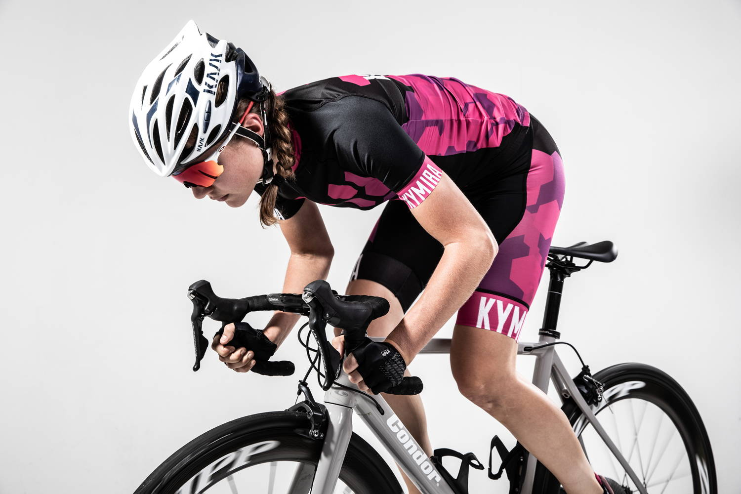 Female Cyclist Wearing KYMIRA Sport Cyclewear