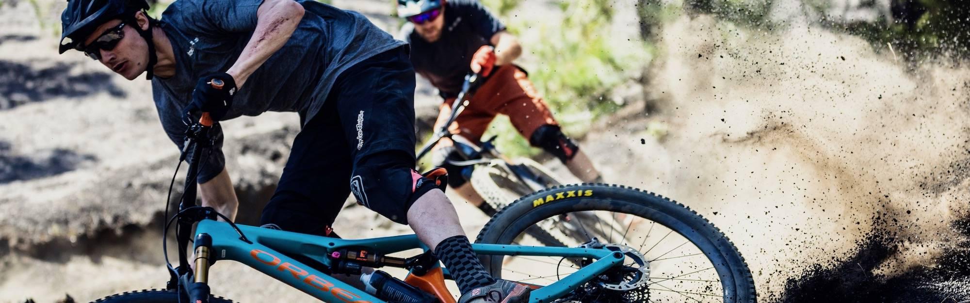 Riding on Orbea mountain bikes.