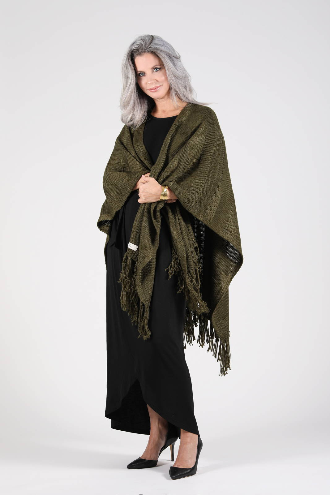 Model wearing the Cahaya Dress in black and the Kuwala Fringe Wrap in olive, by illuminative