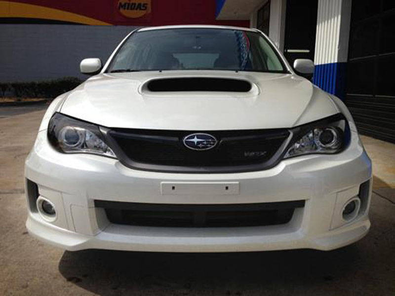 Subaru with Tint Lamin-x headlight tint film covers