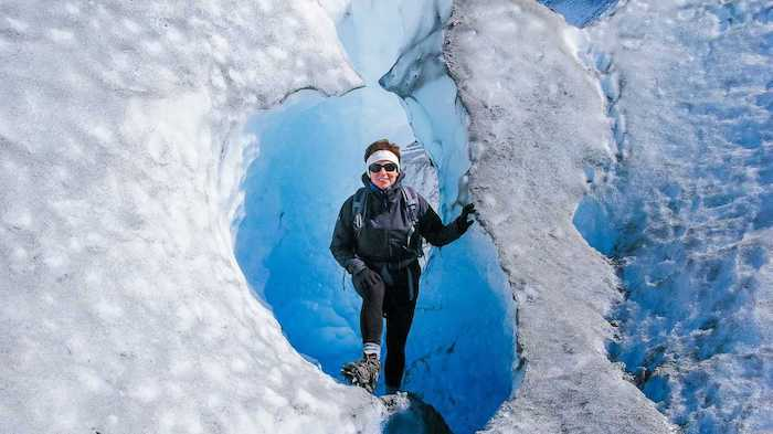 women hikes glaciers with True Lemon drink mix