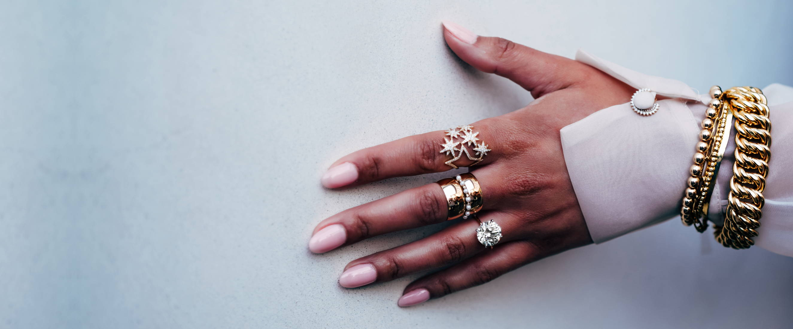 Hand wearing Ring Concierge jewelry