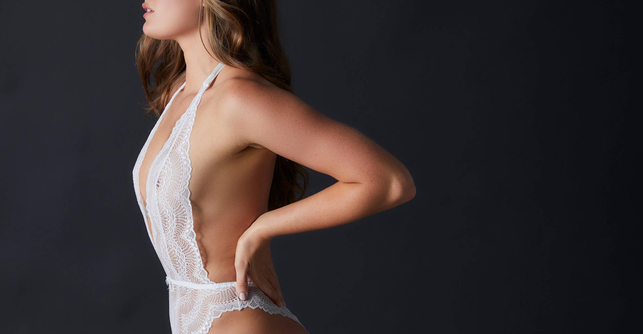 Woman wearing the Journelle Natalia Bodysuit in Alabaster White