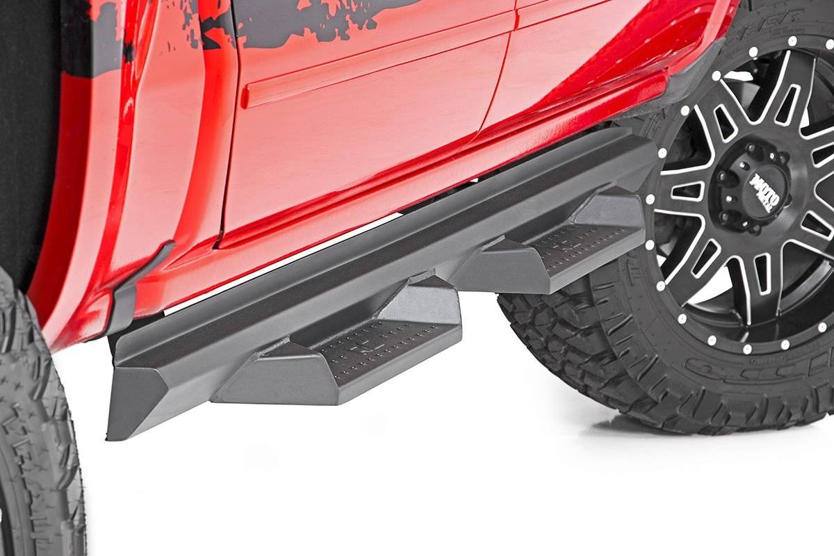 Red Chevy Truck with Bag Lenght DS2 Drop Steps on white background