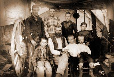 Pioneer family relaxes for a photograph