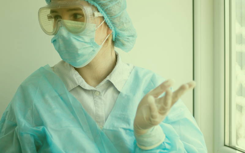 Doctor wearing a face mask and gloves