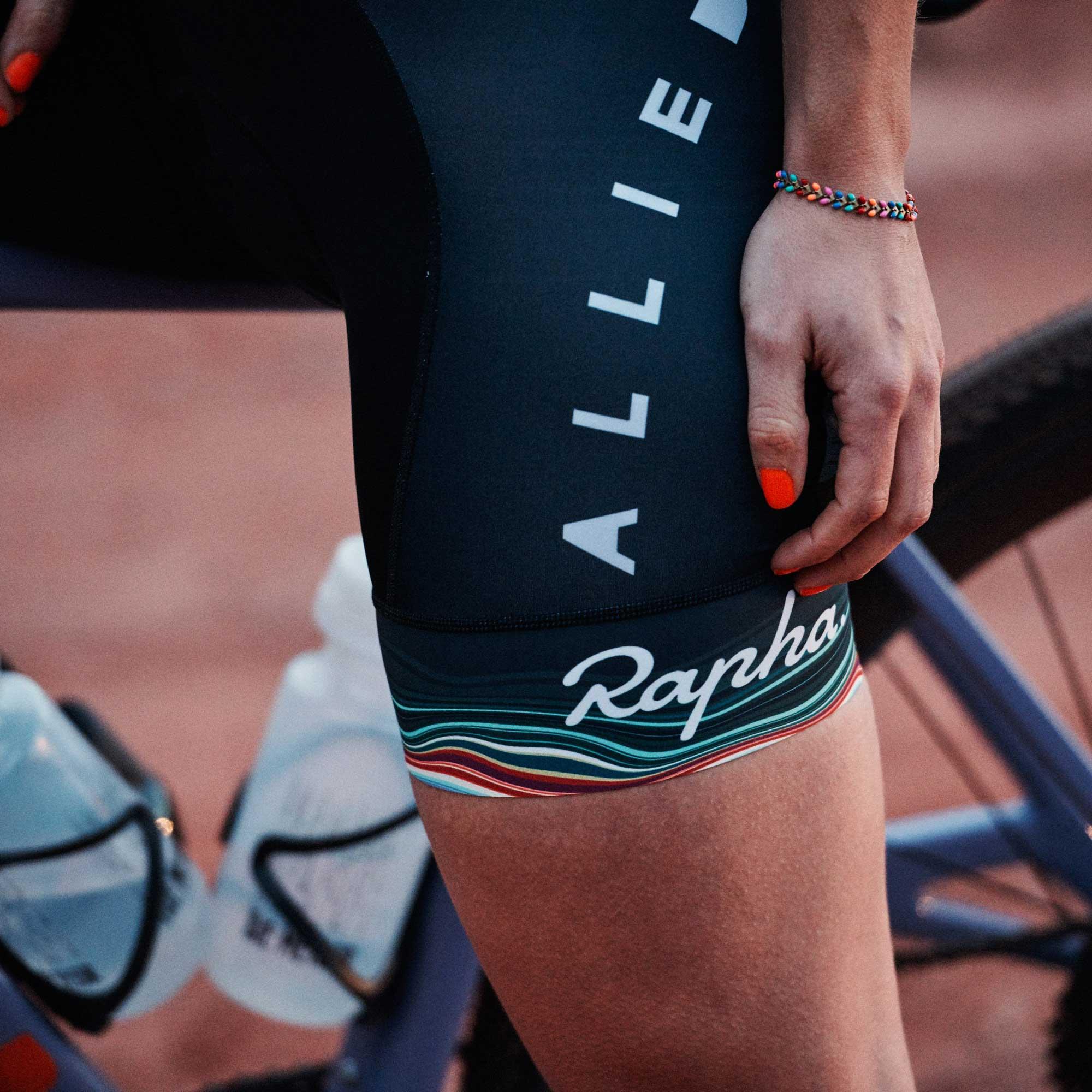 Katie Kantzes sitting on a bike wearing Allied Rapha shorts