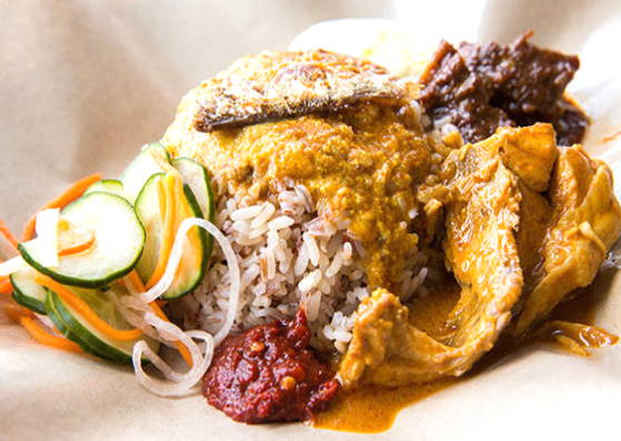 An opened packet of nasi dagang