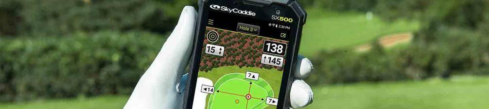 SkyCaddie SX500 golf GPS handheld in a golfer's gloved hand