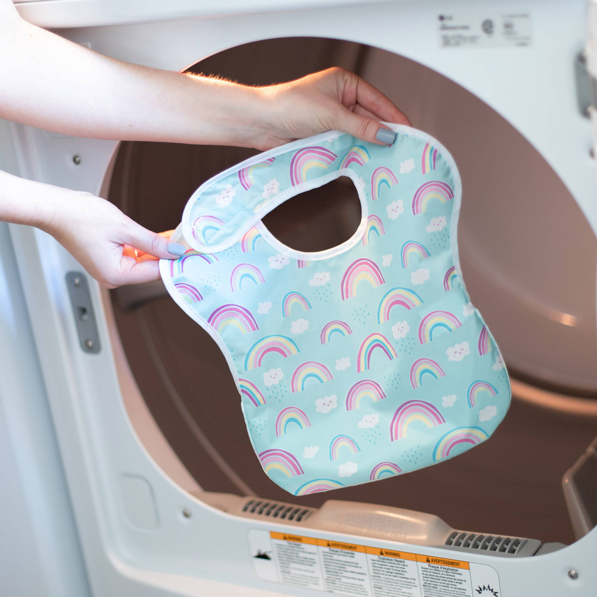 rainbow baby bib going into washing machine