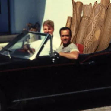 Our founders in a car