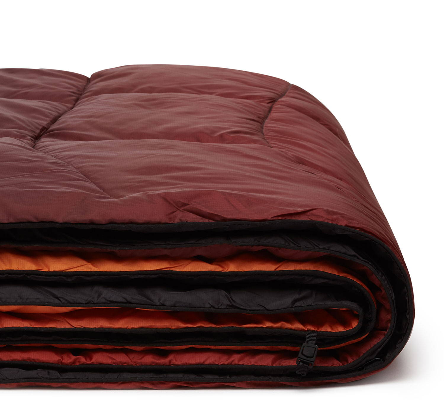 Folded red outdoor camping blanket Rumpl