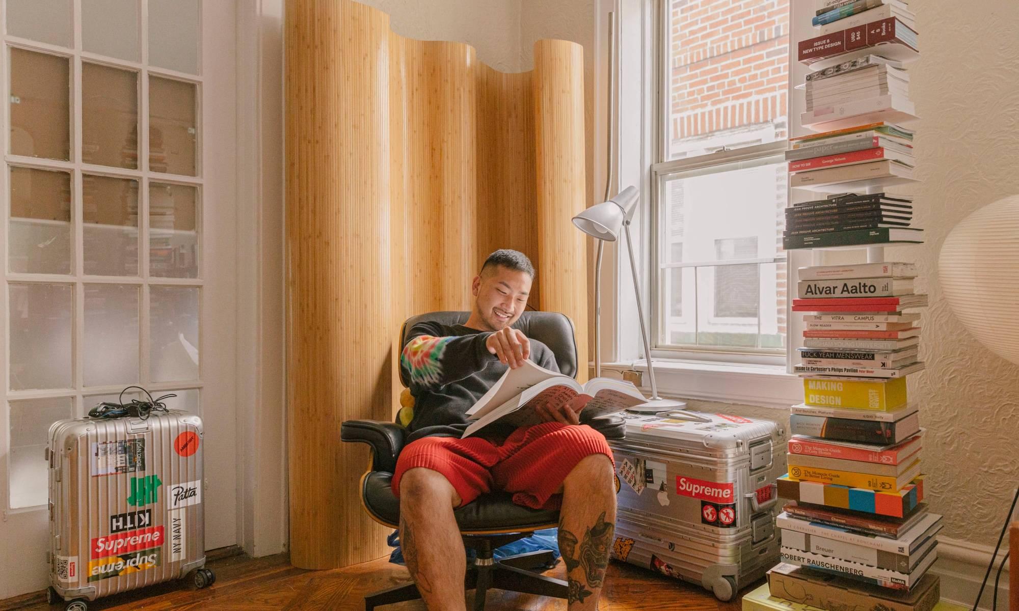 Justin Ryan Kim in an eames chair.