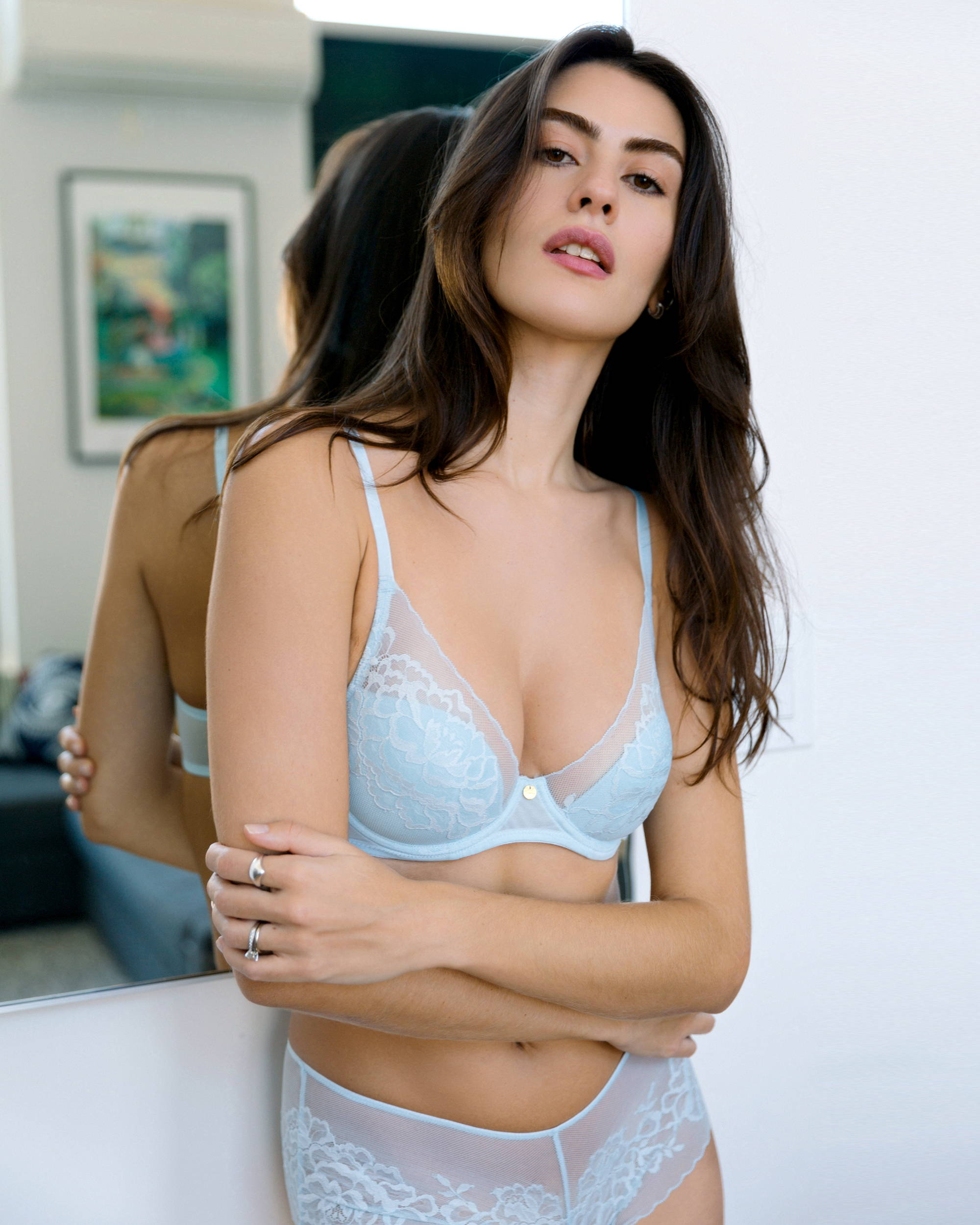 Woman wearing the Natori Flora Contour Bra in fresh spring blue