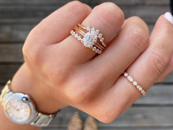 hand with several diamonds rings