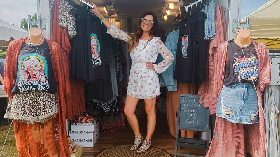 Wanderer Traveling Boutique owner standing in traveling boutique