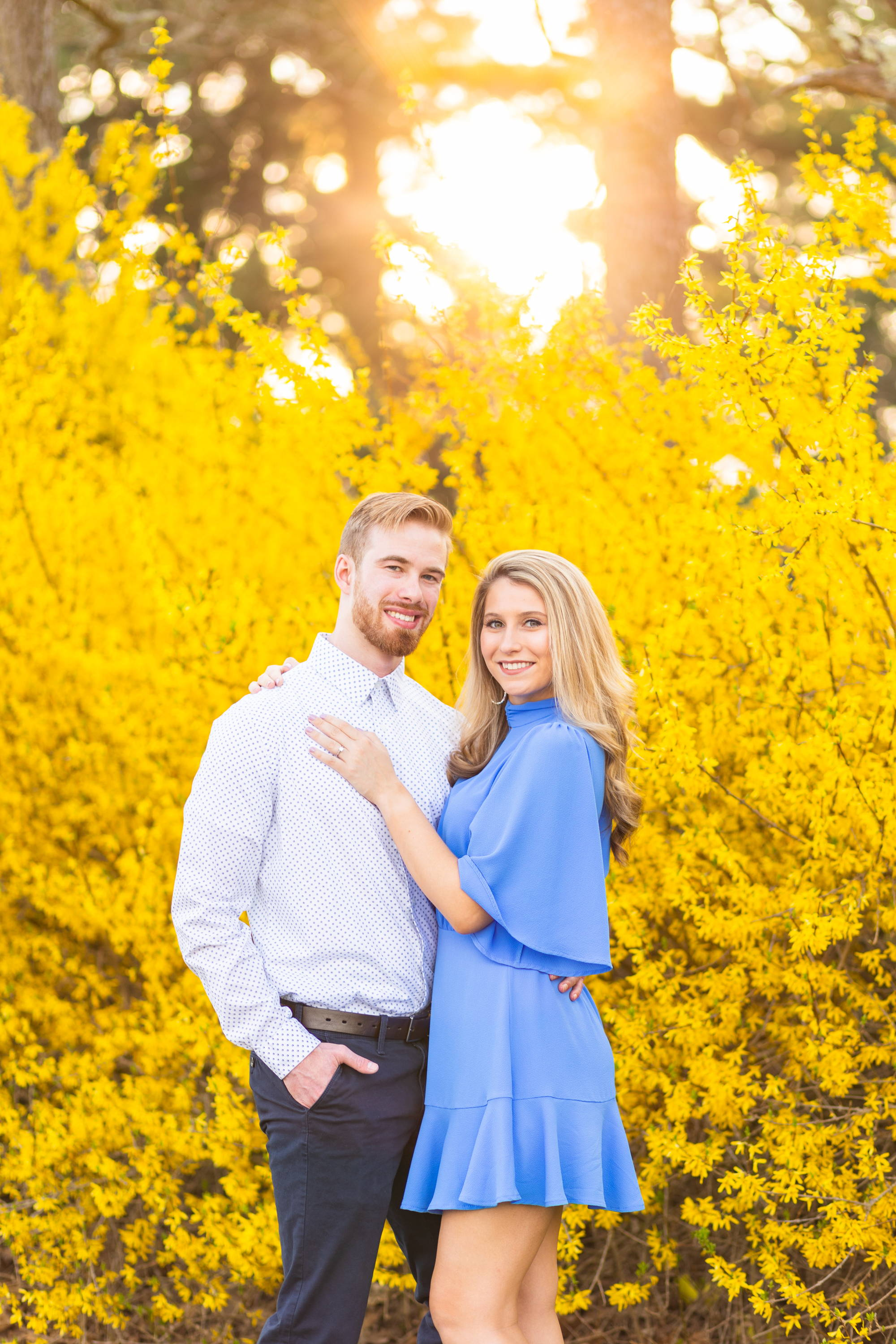 Henne Engagement Ring Couple Kyle & Alyssa Amidst a Backdrop of Yellow Flowers at Sunset