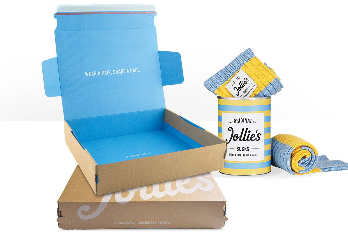 High quality printed packaging for online businesses. Jollies Socks vibrant blue unboxing experience, sleek kraft brown with white overprinted exterior.